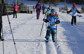 Young boy skiing as part of the Visma Ski Classics for kids event