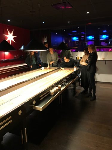 Management trainees playing shuffle board
