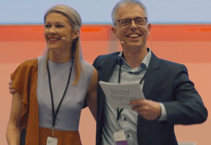 Ellen Marie and CIO Finn Uldum on stage in Madrid, where they flew close to 1000 employees in May