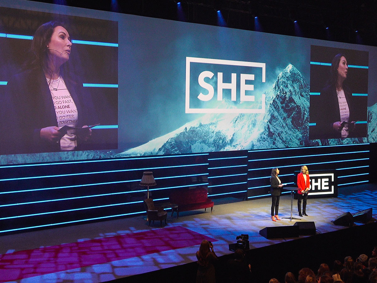 The organisers of She Conference talking on stage