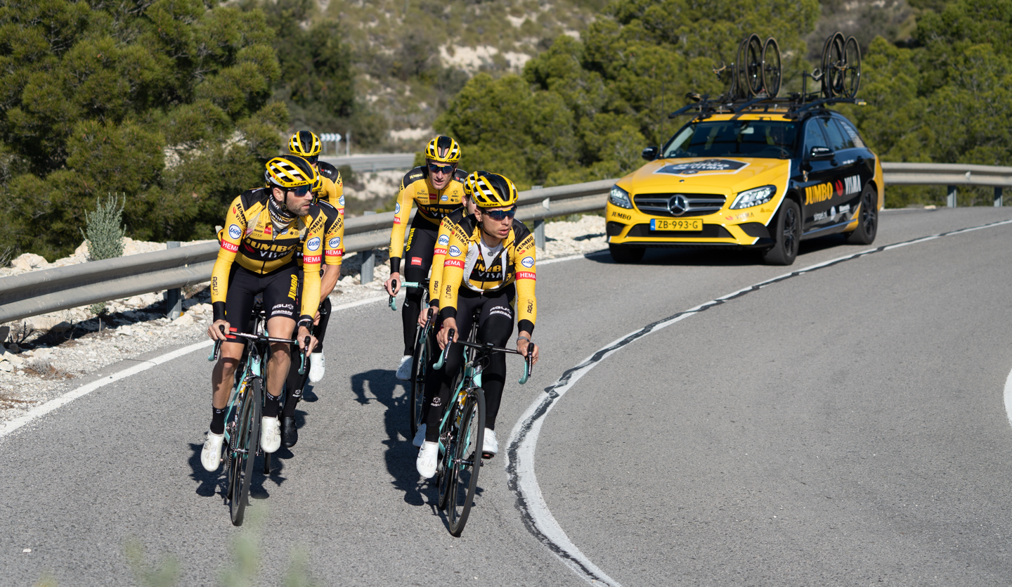 Closeup of the team Jumbo-Visma riders cycling on the road