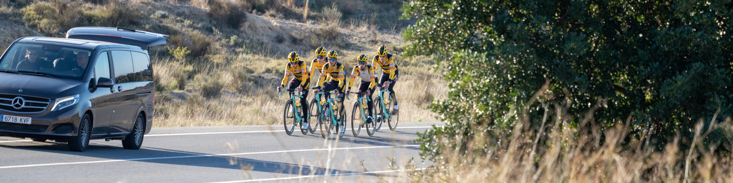 The team Jumbo-Visma riders cycling on the road