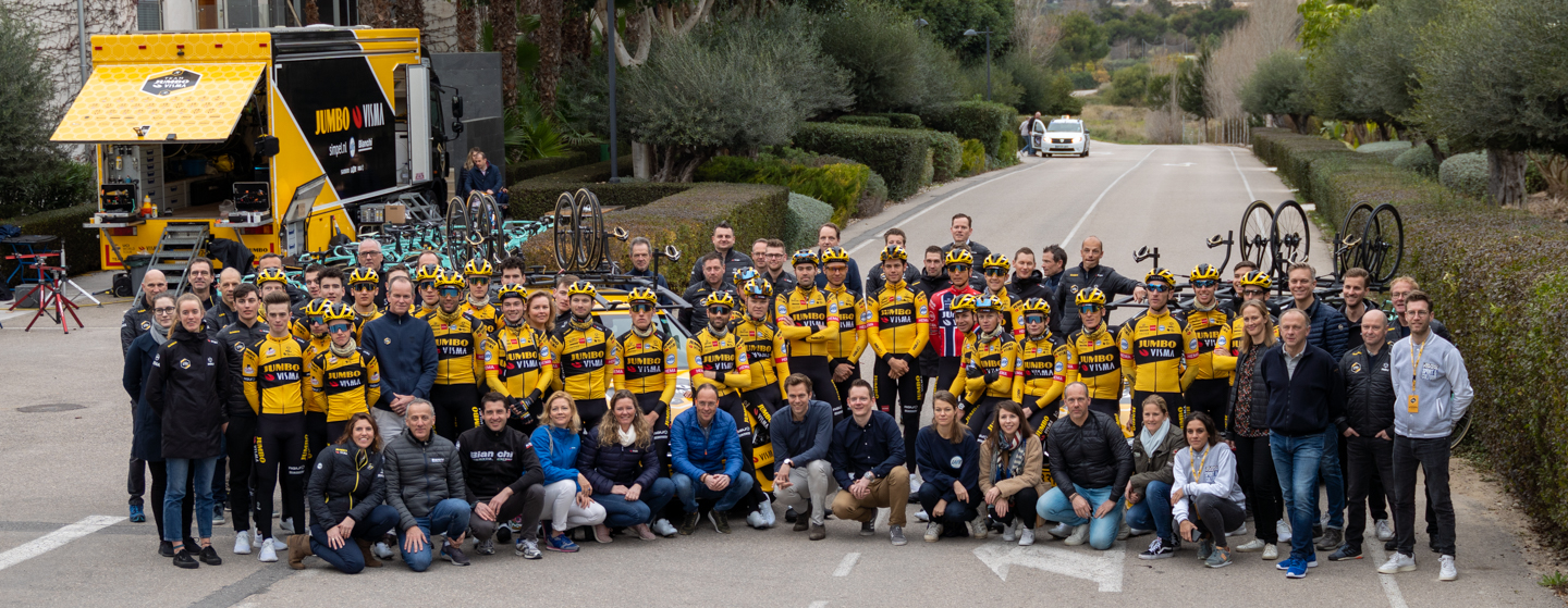 A group photo from location with Team Jumbo-Visma riders, staff, sponsors and media teams