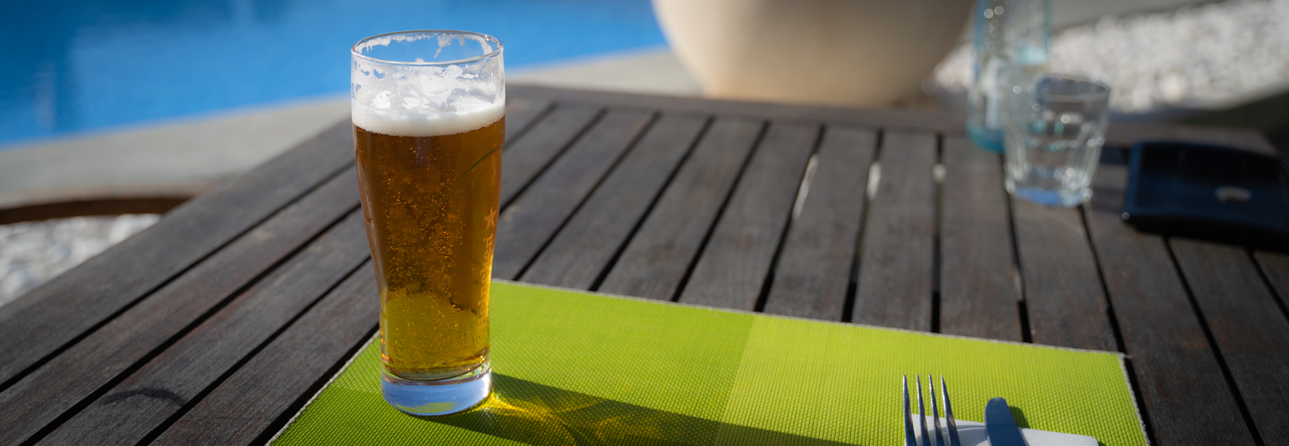 Picture of a beer glass in the sun