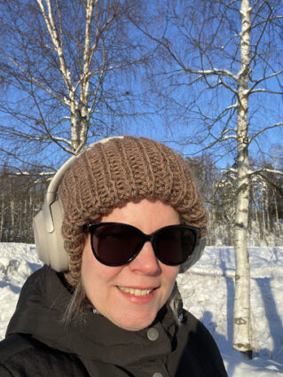 Anna Kiminki outdoors with headphones