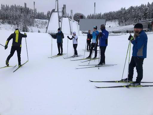 Coach showing ski technique