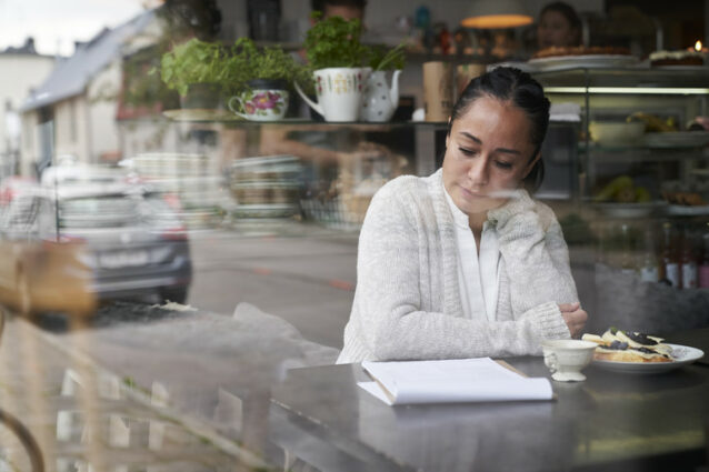 Woman looking at a paper report