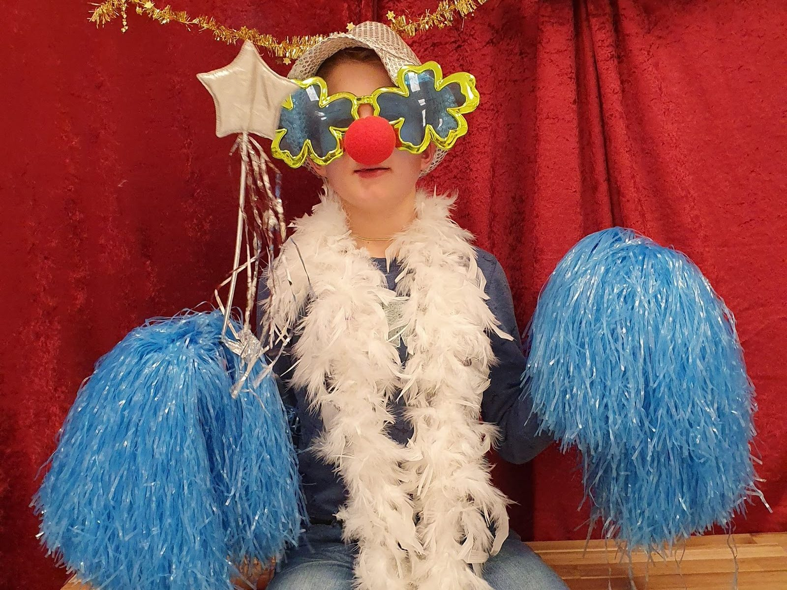 A child dressed up for a photo during the winter wonderland party that Visma Raet initiated for students, teachers, and parents at a school for children with Down syndrome