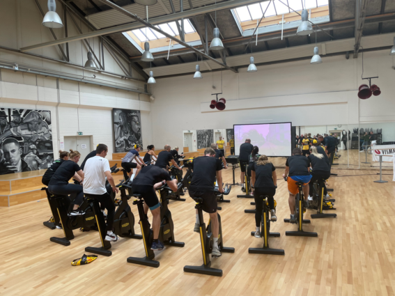 The Visma e-conomic employees during a spinning class led by one of the pro riders of Team Jumbo-Visma: Anouska Koster.