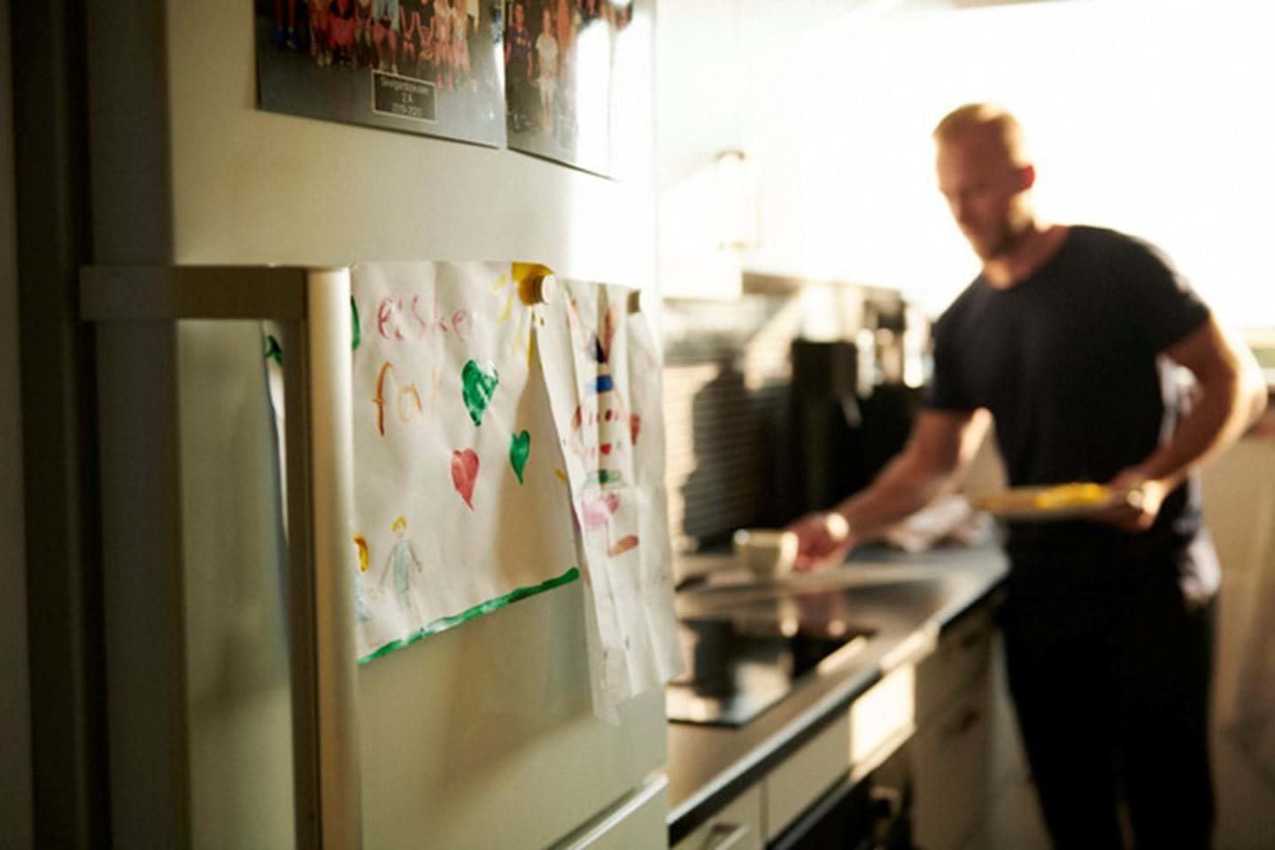 A man prepares his morning breakfast in the kitchen before work